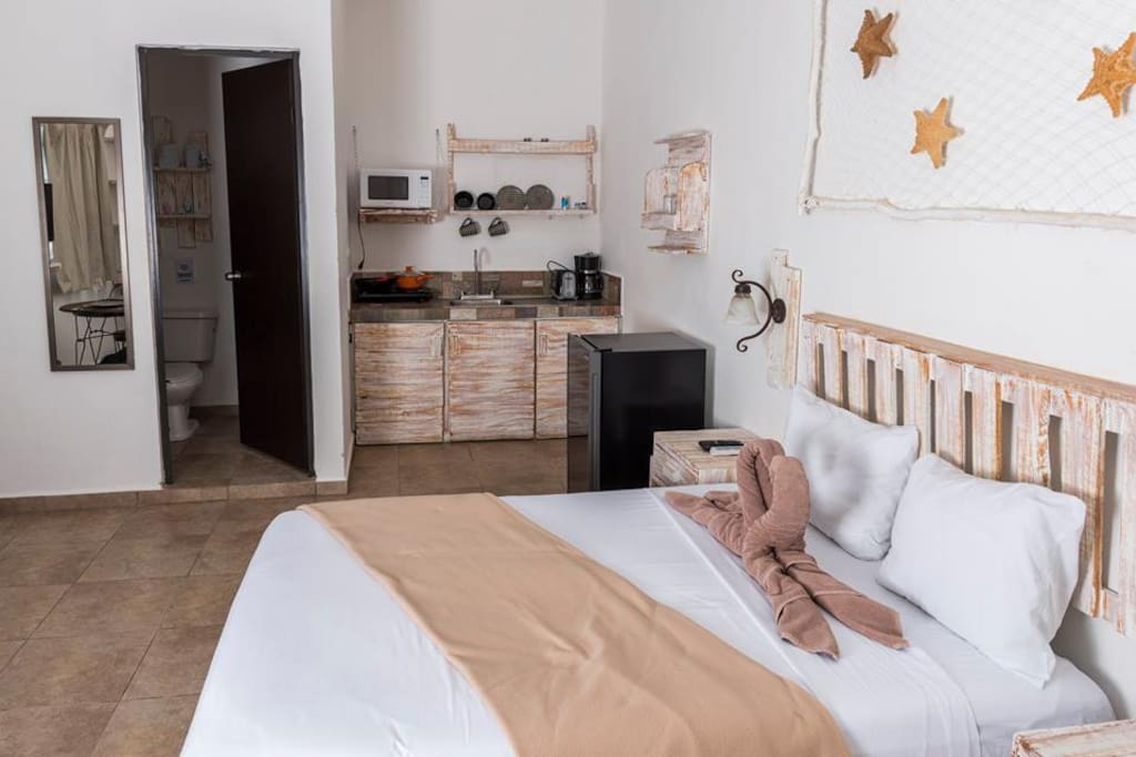 Cozy studio, with bed, kitchenette, and bathroom