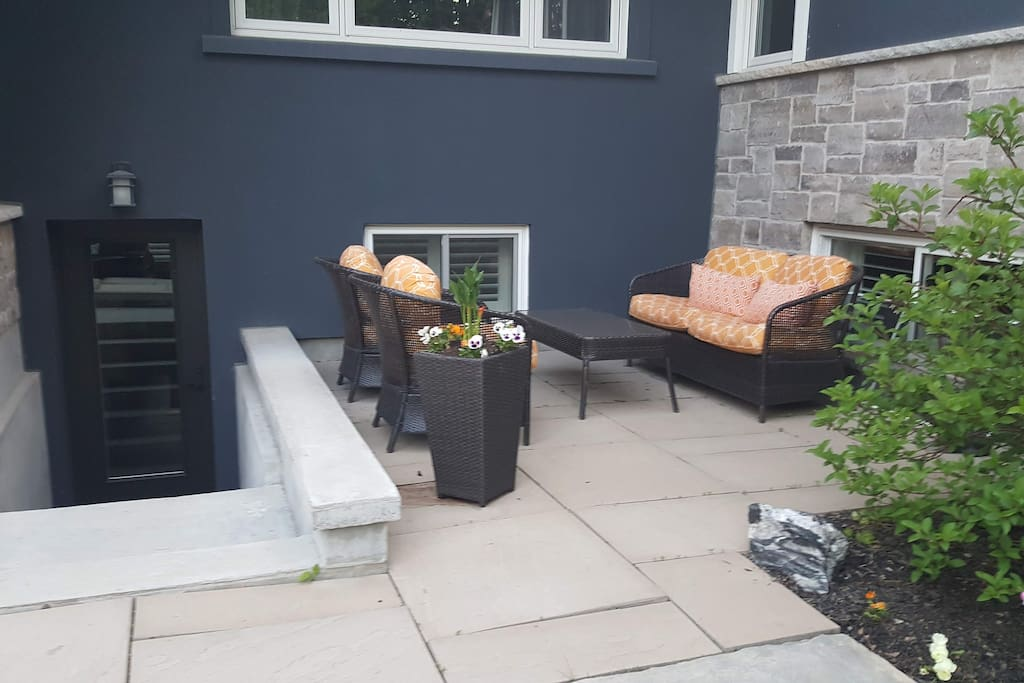 Private apartment entrance with access to patio
