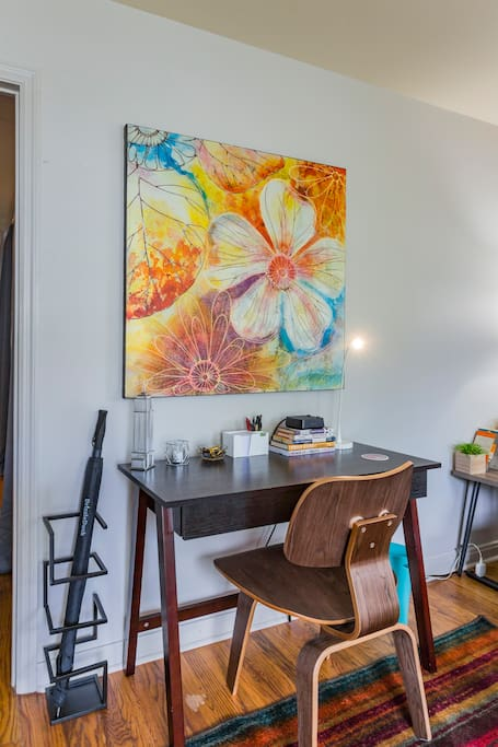 Comfortable working/desk space in living room, complete with charging station and supplies (pens, post-it notes, etc.).  Wi-fi available throughout apartment.