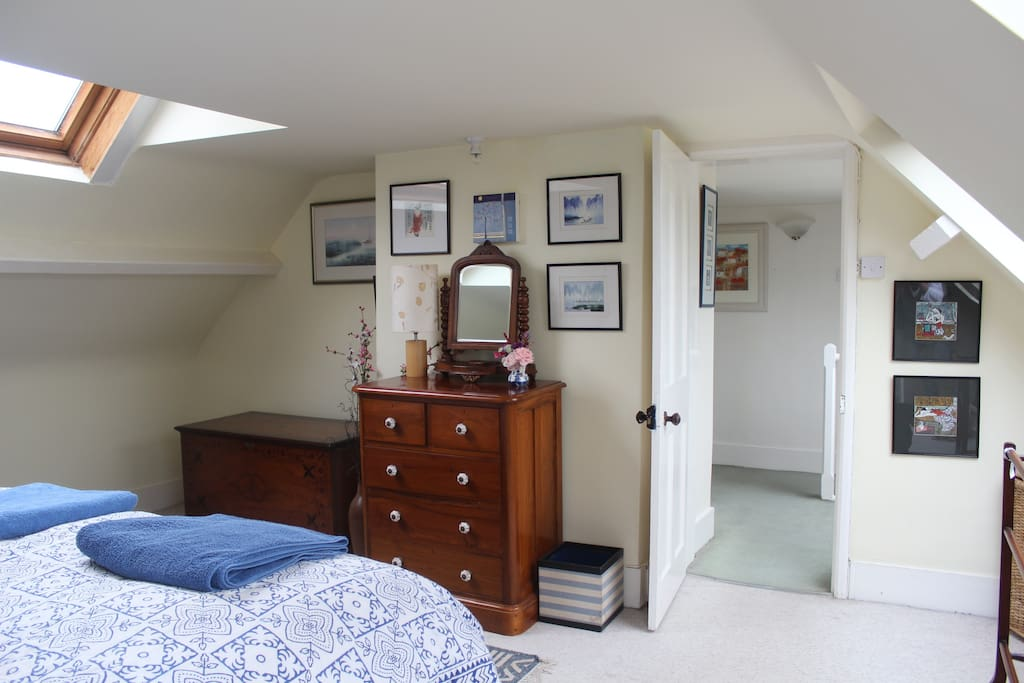 Bedroom view to rest of floor, wardrobe and private bathroom