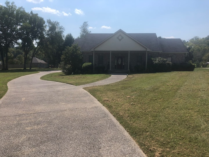 Private and modern family style home on 1 acre lot