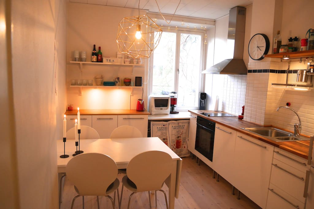 Kitchen - able to expand the table and adding two extra available chairs, seating 6 persons.