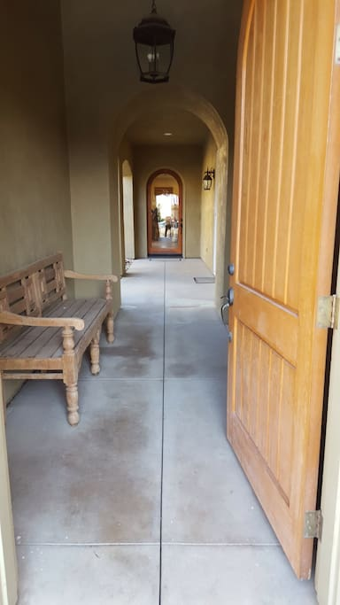 Front entrance into private enclosed courtyard with fireplace.  Casita entrance located in here as well.