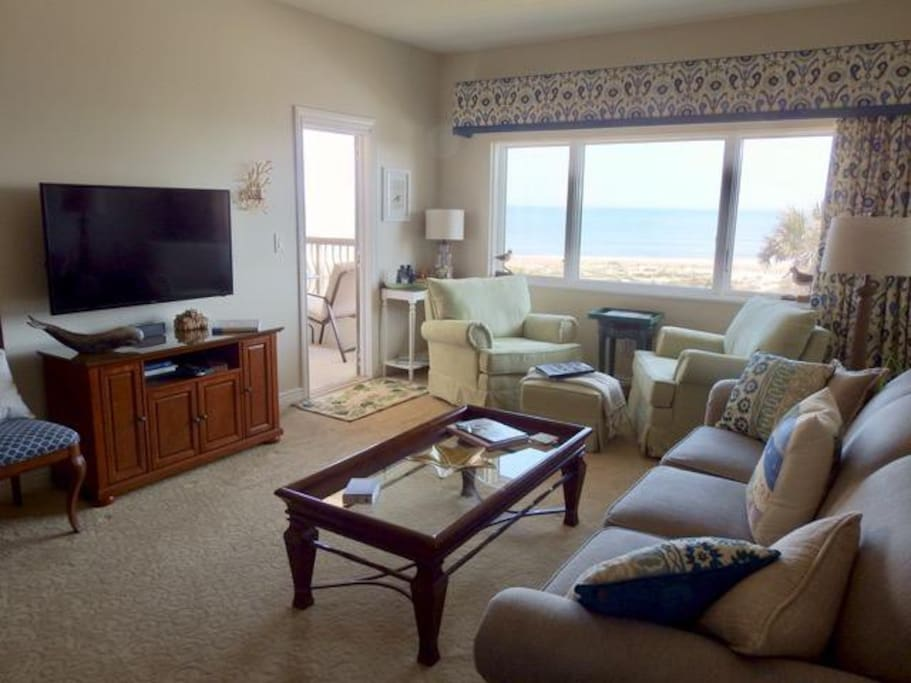 "View of living room and ocean from the kitchen. ""This condo is lovely. Very comfortable and homey. VERY clean and with lovely views."""