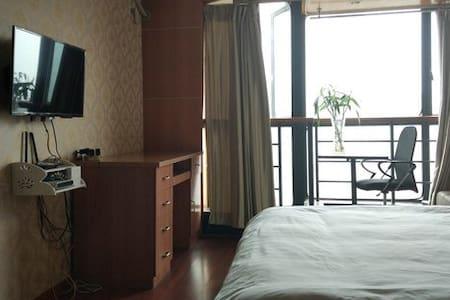 简约舒适温馨大床房 - Appartement