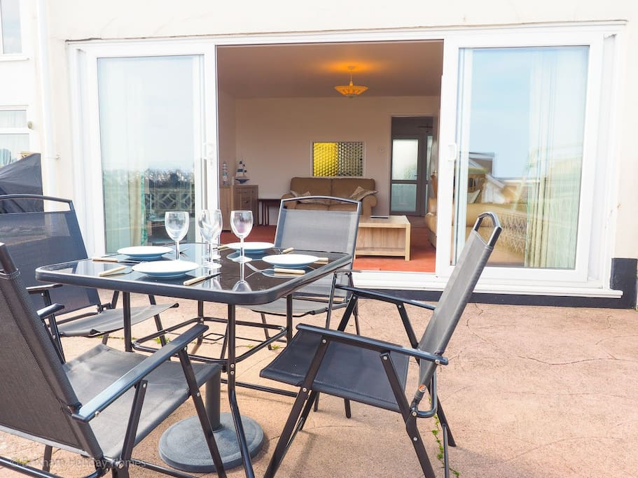 Rear patio with table and chairs for 4
