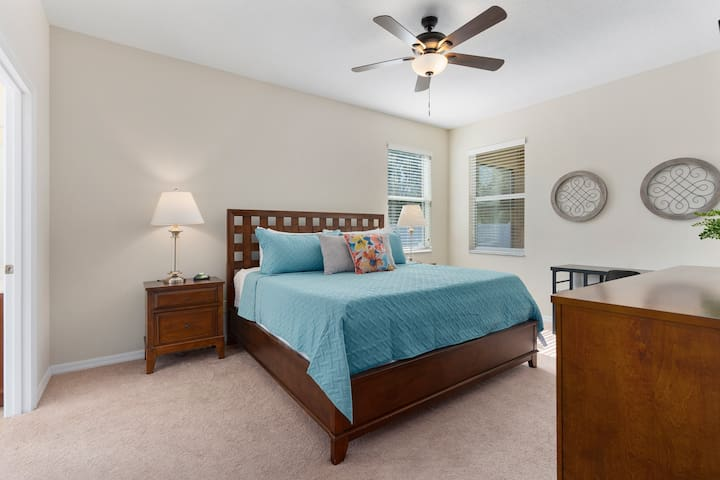 """The first floor master bedroom features a King size bed with memory foam, a 43"""" smart TV, walk-in closet with pack n play and sound machine, master bath & desk for travelers that may need to do a little work on their getaway."""