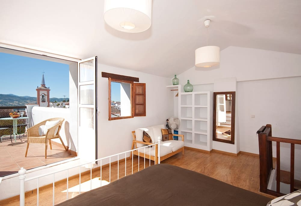 Gorgeous light filled master bedroom leading on to sun terrace