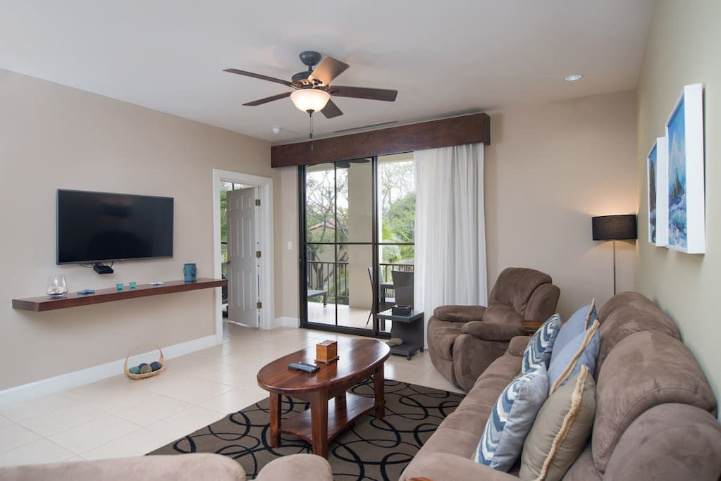 Large and bright living room with flat screen tv