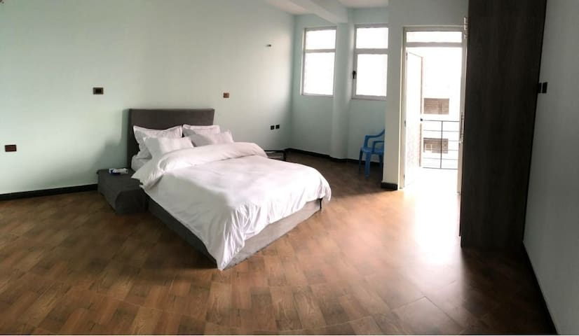 Specious Master bedroom with city view balcony. Bed with brand new Comfortable mattress