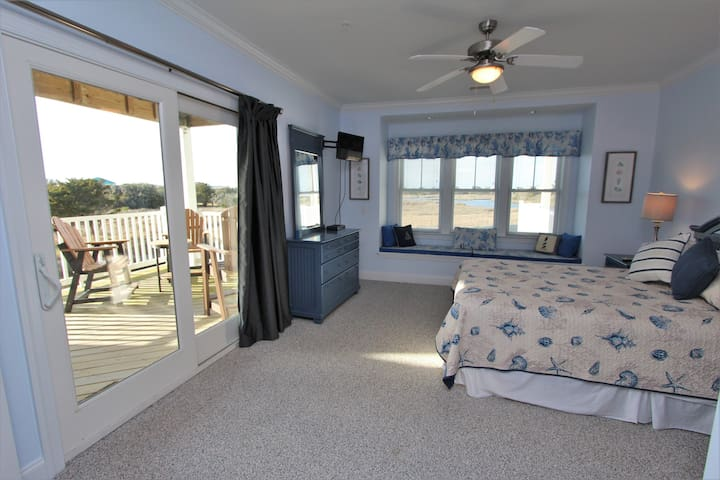 Master Bedroom 1 with King Bed, Water View and Balcony Access