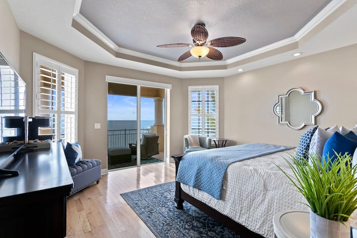 Upstairs master bedroom with king bed + TV, Keurig, and private balcony