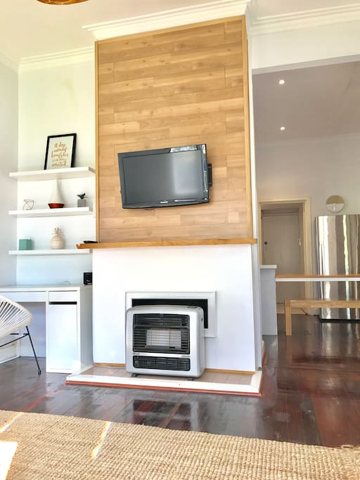Lounge room with tv and gas heater