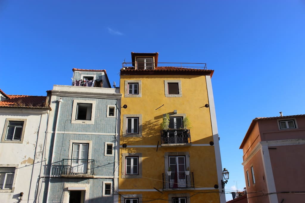 """The characterful yellow home where you will be staying, in the square of the famous """"Market of Thieves"""""""