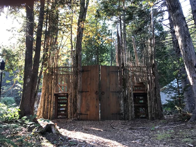 The fantasy gates we built as an entrance to our village of tiny homes