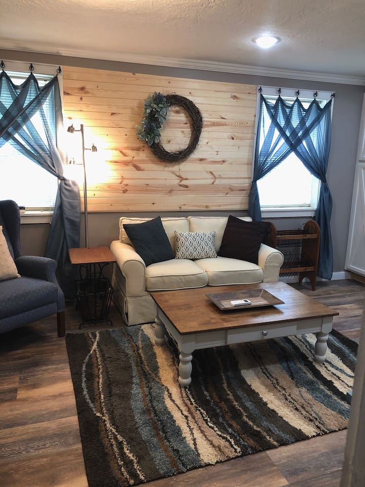 Comfy, inviting living area with shiplap accents