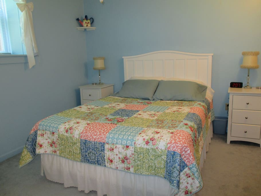 Queen bed and twin in this room with a shared bath nearby