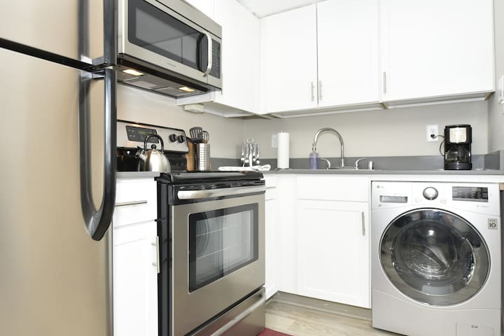 Wash your laundry with our modern style front loader washer/dryer!