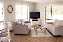 Lounge area including sofa bed, comfortable 3 seater couch and flat screen TV including DVD player
