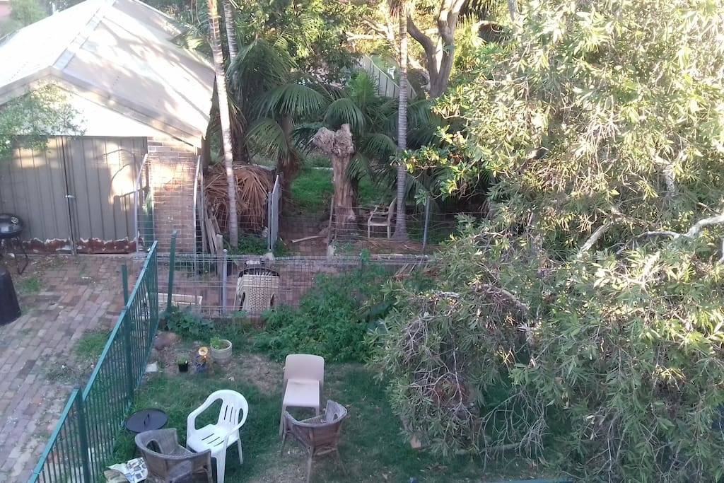 View of the garden from the upstairs terrace area