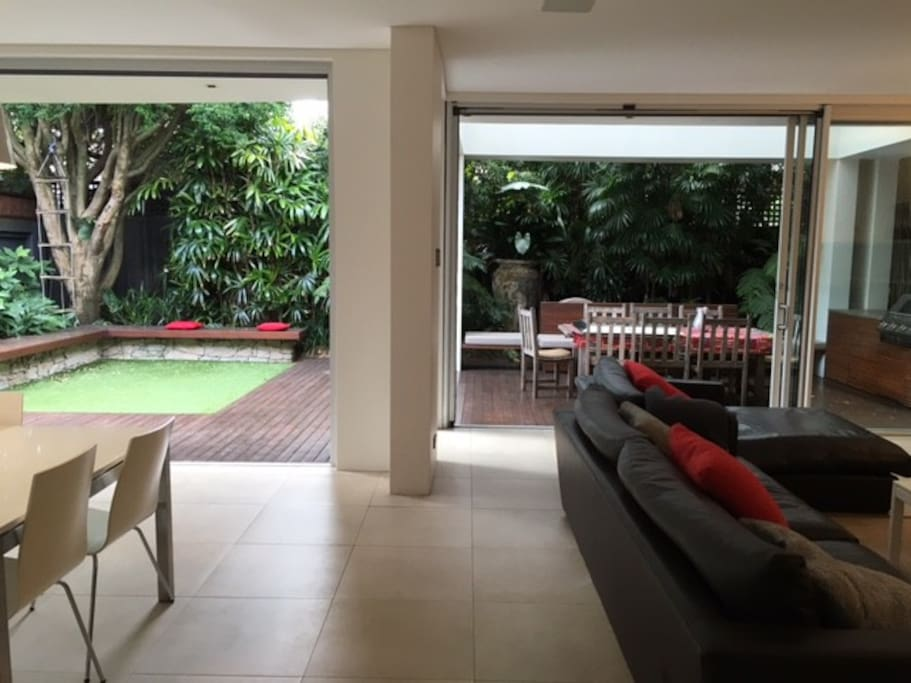 Wide open plan living / dining area opening on to outside and al fresco dining