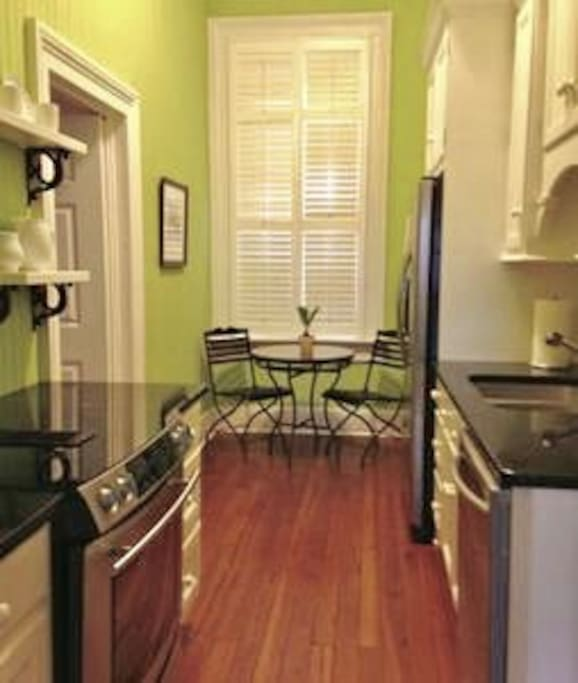 Fully equipped kitchen with custom cabinets, quartz and stainless steel.