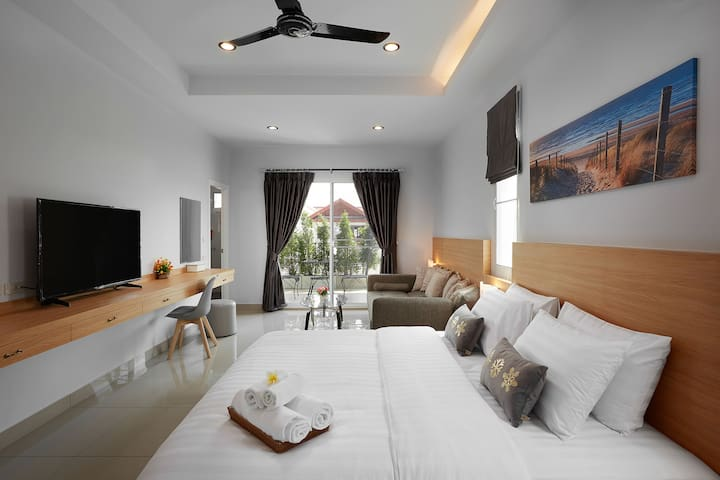 Master suite with King bed + Sofa bed + Balcony