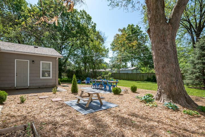 Fenced in backyard with seating for 8, a picnic table for the kids, a firepit, and green space to play!
