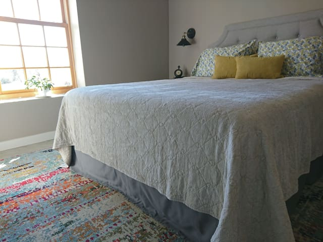 The bed has a gray bed skirt, protective mattress  and pillow covers, comfortable sheets, knitted blanket, then a gray quilt. Plus two memory foam pillows, two medium firm pillows with two suede decor pillows.  All for a goodnight sleep!