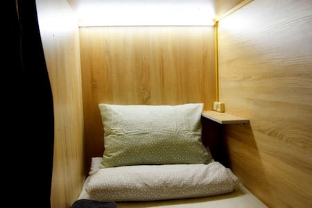 Single capsule room. Capsule Hotel Tolmachevo
