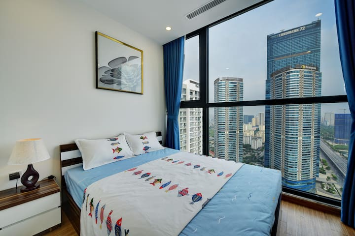 Cozy bedroom with sky view and street view
