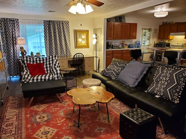 The main room has an open Floorplan to living room, kitchen, and dining. Relax, watch the smart tv on Wi-Fi on your own platform or a logged in Netflix courtesy amenity.  Xbox also present with guest account access/blueray/DVD player.