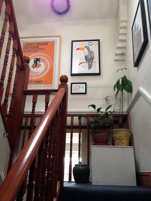 An avocado plant and mini gallery lead you up to your attic bedroom.