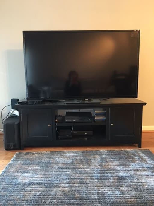 "60"" TV, Xbox, and Blue-ray."