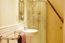 Family bathroom (with shower not bath), South Wing, with door to the lounge and door to twin bedroom.