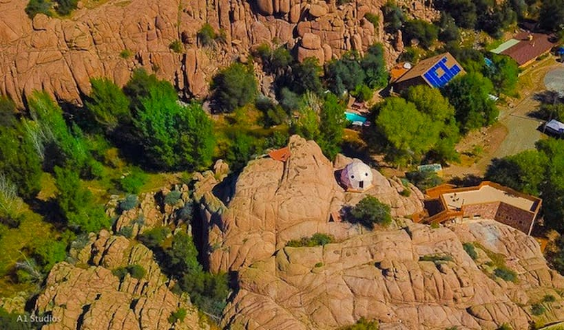 Aerial view of Heaven on Earth Retreat and Wildlife Sanctuary which tucked into one of canyon in an extensive labyrinth of canyons. Do you see the pool, pond, trail (on the left) and clifftop dome? Do you see the Cave Castle rooftop on the right?
