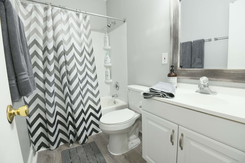 Freshly renovated bathroom complete with necessary amenities; shampoo, conditioner, body soap, hair dryer, towels, etc.