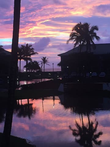 "Wake up to the sunrise!! View from your comfy Cal King bed which looks out over the lanai, lagoon to the ocean .....true ""Resort feel"" view! 3 minute walk to the Beach or Kauai Beach Resort next door, free access to all pools & jacuzzis!"