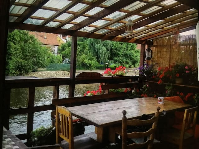 Private double  room with river view at Skippy's