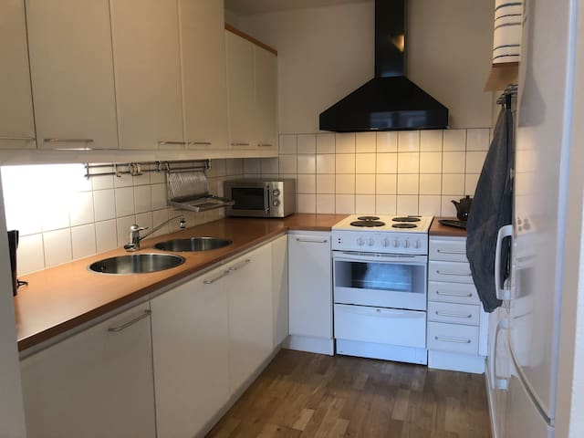 Kitchen with stove, oven, microwave, toaster, coffee maker, fridge and freezer.