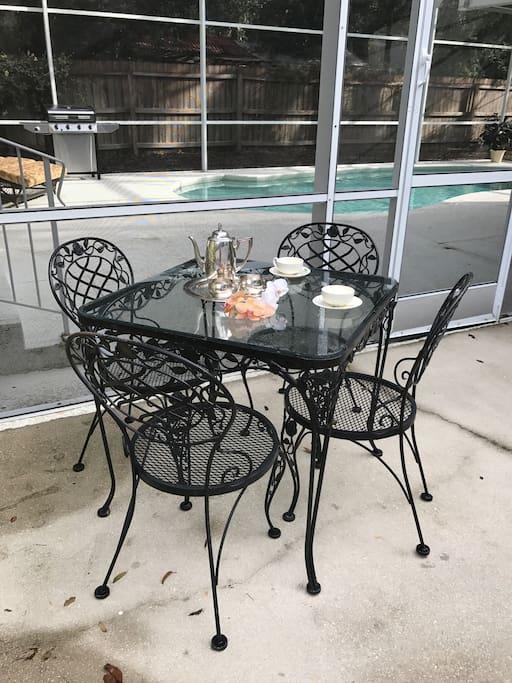 Patio seating outside pool enclosure