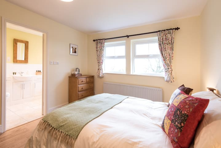 """""""Rowan"""" has ensuite bathroom with shower tap and easterly view to the sea."""