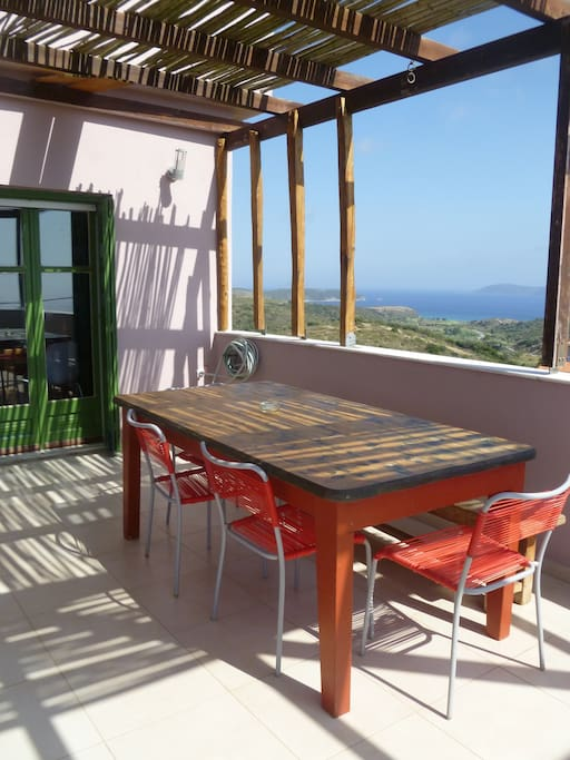 Shaded dining area with sea views