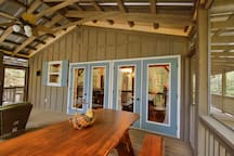 Lots of doors open to the screen porch to expand your living area.