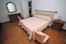 Quiet and spacious master bedroom with queen-size bed and new mattress.