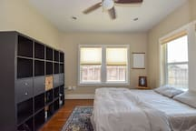 View of bedroom 1, equipped with ceiling fan, dimmable recessed lighting, ensuring complete comfort.