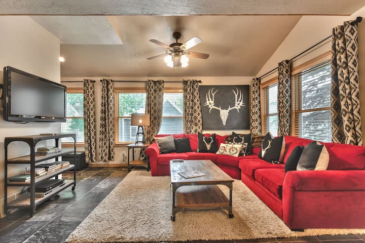 Living Room with Comfortable Sectional Sofa, TV, Gas Fireplace and Plenty of Natural Light