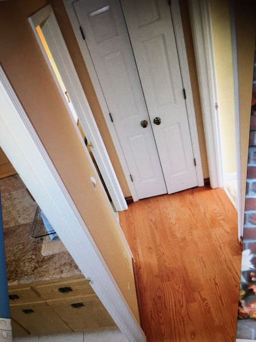 Hallway in the middle with more closets