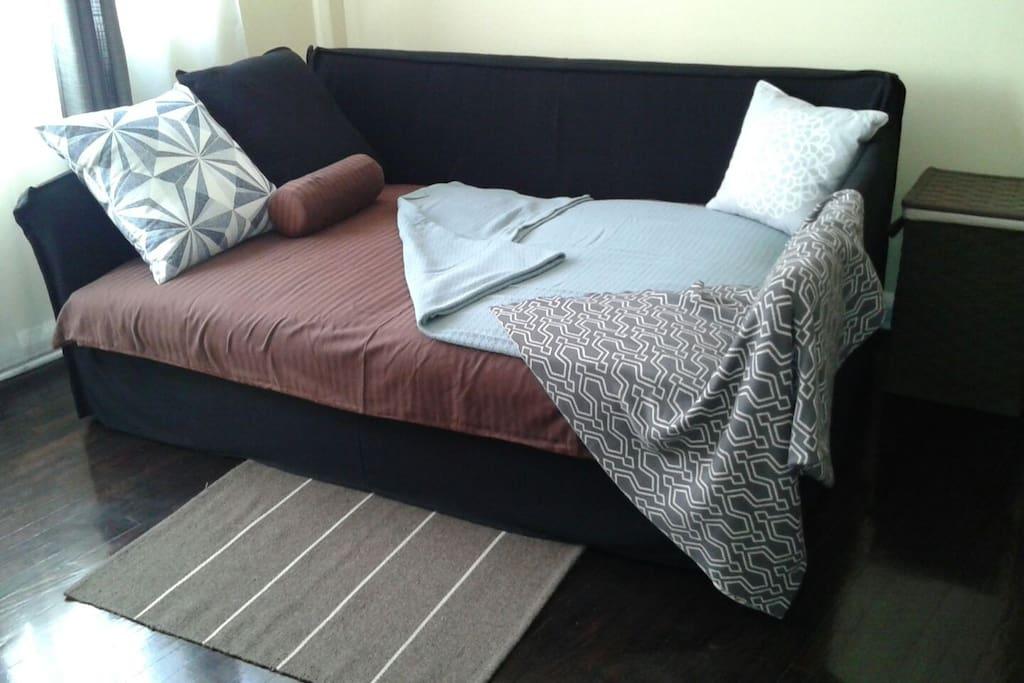 Cozy bed, well illuminated room