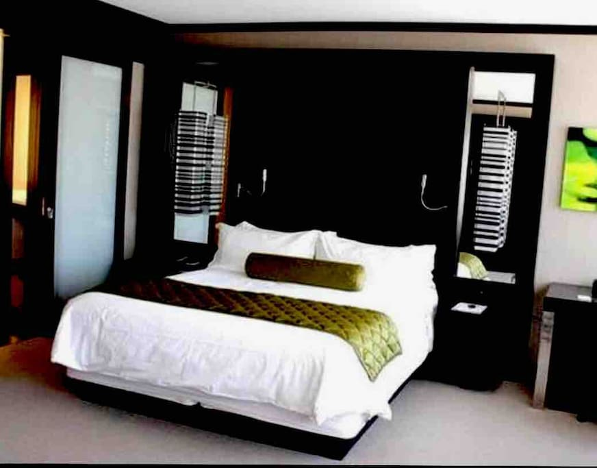 King size bed, soft high quality linens, charging outlets on both nightstands, his and her reading lights